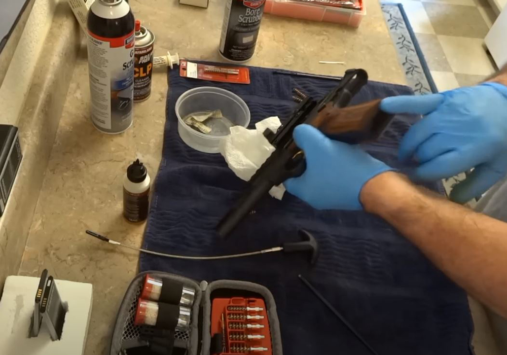 Clean the magazine using a cleaning aerosol solvent